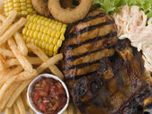 Barbeque Chicken and Ribs with Fries Slaw and Salsa — Stock Photo