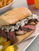 Steak and Roquefort Sandwich with Fries Gherkins and Chillies — Stock Photo
