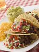 Beef Tacos with Cheese Salad and Guacamole — Stock Photo
