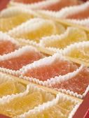 Jellied fruits in paper cases — Stockfoto