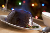 Christmas Pudding with a Brandy Flambe — Stock Photo
