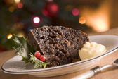 Portion of Christmas Pudding with Brandy Butter — Stock Photo