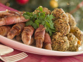 Plate of Pigs in Blankets and Chestnut Stuffing Balls — Stock Photo