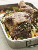 Slow Roasted Shoulder of Lamb Stuffed with Herbs de Provence Roa — Stock Photo