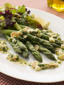 Asparagus Spears with Polonaise Vinaigrette and Salad Leaves — Stock Photo