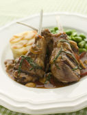 Grilled Lamb Cutlets Chasseur sauce Pomme Anna and Baby Broad be — Stockfoto