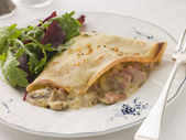 Savoury Pancake filled with Ham Cheese and Mushrooms with dresse — Stock Photo