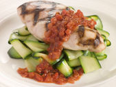 Chargrilled Chicken Breast with Courgette Ribbons and Tomato Con — Stock Photo