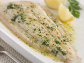 Whole Lemon Sole Meuniere with Lemon and Parsley Garnish — Stock Photo
