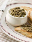 Green Olive Tapenade with toasted baguette — Stock Photo