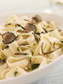 Tagaliatelli with Sliced Black Truffles — Stock Photo