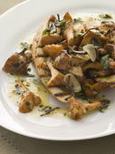 Wild Mushrooms Sauteed in Garlic Butter with Char grilled Baguet — Stock Photo