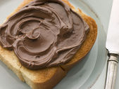 Slice of Toasted brioche with Chocolate Spread — Stock Photo