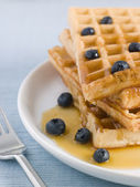 Waffles with Caramel Syrup and Blueberries — Stock Photo