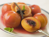 Bowl of Peaches Poached in Sauternes Wine — Stock Photo