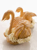 Two Choux Swans filled with Chantilly Cream — Stock Photo