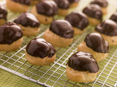Chocolate dipped Profiteroles — Stock Photo