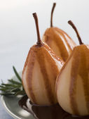 Pear Poached with Rosemary and a Chocolate sauce — Stock Photo