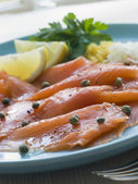 Scottish Smoked Salmon with Lemon Capers and Egg — Stock Photo