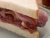 Bacon Sandwich on White Bread with Tomato Ketchup — Stock Photo