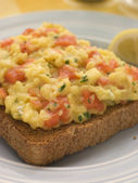 Scrambled Egg and Smoked Salmon on Brown Toast — Stock Photo