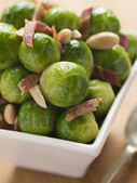 Brussel Sprouts with Fried Bacon and Almonds — Stock Photo