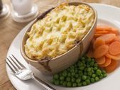 Individual Cottage Pie with Peas and Carrots — Stock Photo