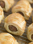 Sausage Rolls on a Cooling Rack — Stock Photo