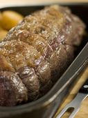 Roast Topside of British Beef in a Tray with Roast Potatoes — Stock Photo