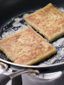 Potato Farls Frying in Butter — Stock Photo