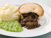 Steak Pie and Mash with Mushy Peas — Stock Photo