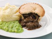 Steak Pie and Mash with Mushy Peas — Stock Photo