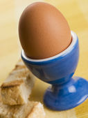 Soft Boiled Egg in a Egg Cup with Toasted Soldiers — Stock Photo