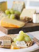 Plate of Cheese and Biscuits with a Cheese Board — Stock Photo