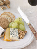 Plate of Cheese and Biscuits with a Glass of Port — Stock Photo