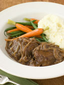 Faggots in Onion Gravy with Mashed Potato and Vegetables — Stock Photo