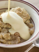 Bowl of Apple Crumble with Custard — Stock Photo