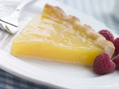 Slice of Lemon Curd Tart with English Raspberries — Stock Photo