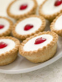 Plate of Cherry Bakewell Tarts — Stock Photo