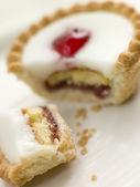 Bite of a Cherry Bakewell Tart — Stock Photo