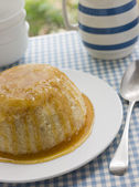 Steamed Syrup Sponge with a jug of Custard — Stock Photo