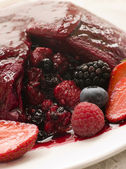 Traditional Summer Pudding with a scoop out — Stock Photo