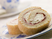 Cream and Strawberry Sponge Roll with Tea — Stock Photo