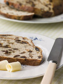 Slice of Barm Brack with Butter — Stock Photo