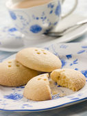 Wellington Button Biscuits with a Cup of Tea — Stock Photo