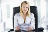 Businesswoman sitting in office with personal organizer — Stock Photo