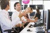 Five businesspeople in office space with a ball being thrown — Stock Photo