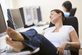 Woman in computer room sleeping — Stock Photo