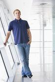 Man standing in corridor — Stock Photo
