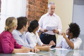 Five businesspeople in boardroom meeting — Foto Stock